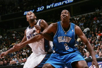 WAHINGTON - NOVEMBER 10:  Dwight Howard #12 of the Orlando Magic battles for rebound position against Brendan Haywood #33 of the Washington Wizards during the game on November 10, 2004 at the MCI Center in Washington D.C.  The Wizards won 106-96. NOTE TO