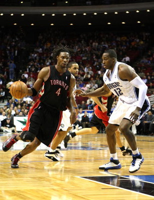 ORLANDO, FL - NOVEMBER 18: Chris Bosh #4 of the Toronto Raptors drives against Dwight Howard #12 of the Orlando Magic during the game on November 18, 2008 at Amway Arena in Orlando, Florida.  NOTE TO USER: User expressly acknowledges and agrees that, by d