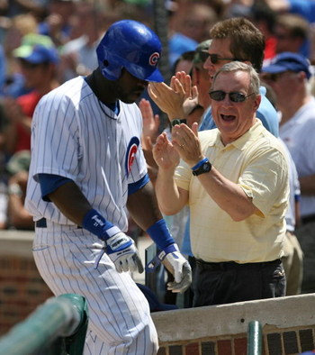 CHICAGO - JULY 26: Senator Richard Durbin (D-IL) joins Chicago Cub fans in cheering Milton Bradley #21 after Bradley scored a run on a play at the plate in the 3rd inning against the Cincinnati Reds on July 26, 2009 at Wrigley Field in Chicago, Illinois.
