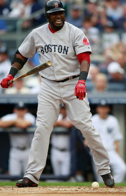 NEW YORK - AUGUST 08:  David Ortiz #34 of the Boston Red Sox grimaces after a pitch during the game on August 8, 2009 at Yankee Stadium in the Bronx borough of New York City.  (Photo by Jared Wickerham/Getty Images)