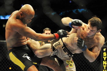 PHILADELPHIA - AUGUST 08:  (L-R) Anderson Silva battles  Forrest Griffin during their light heavyweight bout at UFC 101: Declaration at the Wachovia Center on August 8, 2009 in Philadelphia, Pennsylvania.  (Photo by Jon Kopaloff/Getty Images)