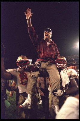 1 Jan 1996:  Head coach Bobby Bowden of the Florida State Seminoles is carried triumphantly off the field by nose guard Andre Wadsworth #8 and tackle Orpheus Roy after defeating the Notre Dame Fighting Irish in the Orange Bowl in Miami, Florida 31-26.  Ma