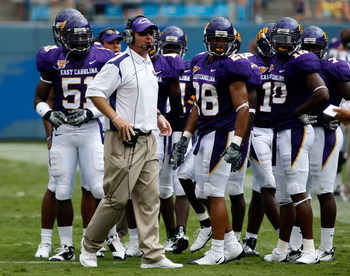 CHARLOTTE, NC - AUGUST 30:  Head coach Skip Holtz of the East Carolina Pirates stands with his team against the Virginia Tech Hokies on August 30, 2008 at Bank of America Stadium in Charlotte, North Carolina.  (Photo by Streeter Lecka/Getty Images)