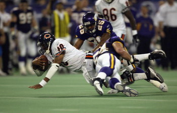 MINNEAPOLIS - OCTOBER 27:  Quarterback Henry Burris #10 of the Chicago Bears is tackled by Greg Biekert #54 and Eric Kelly #25 of the Minnesota Vikings in the fourth quarter at the Hubert H. Humphrey Metrodome on October 27, 2002 in Minneapolis, Minnesota