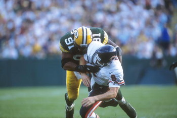 10 Oct 2000:  #91 John Thierry of the Green Bay Packers tackles  #8 Cade McNown of the Chicago Bears during the Bears v Packers game in which the Bears defeated the Packers 27-24 at Lambeau Field in Green Bay, Wisconsin. Mandatory Credit: Jonathan Daniel/
