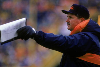 1987:  Head coach Mike Ditka of the Chicago Bears points to the field with his play list from the sidelines during a 1987 season game.  (Photo by Jonathan Daniel/Getty Images)