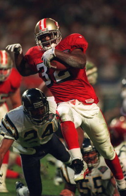 29 Jan 1995: SAN FRANCISCO RUNNING BACK RICKY WATTERS SCORES ON AN 8 YARD PASS FROM QUARTERBACK STEVE YOUNG PAST SAN DIEGO SAFETY STANLEY RICHARD WITH 4:44 LEFT IN THE FIRST HALF DURING THE SECOND QUARTER OF THE SAN FRANCISCO 49ERS VERSUS THE SAN DIEGO CH
