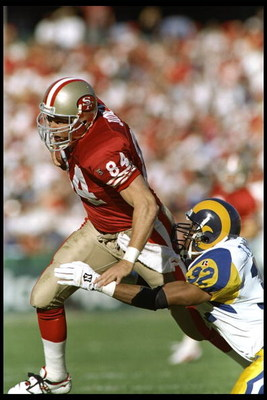 26 Nov 1995:  Defensive back Toby Wright of the St. Louis Rams tries to tackle tight end Brent Jones of the San Francisco 49ers during a game at 3Com Park in San Francisco, California.  The 49ers won the game 41-13.    Mandatory Credit: Otto Greule Jr.  /
