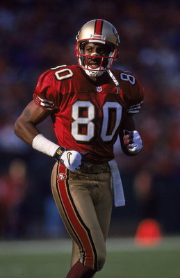 12 Dec 1999:  Jerry Rice #80 of the San Francisco 49ers looks on from the field during the game against the Atlanta Falcons at 3 Comm Park in San Francisco, California. The 49ers defeated the Falcons 26-7. Mandatory Credit: Tom Hauck  /Allsport