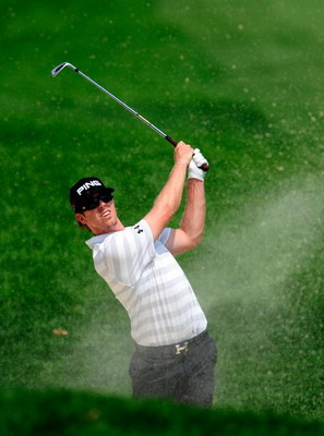 AKRON, OH - AUGUST 09:  Hunter Mahan hits a shot on the first hole during the final round of the WGC-Bridgestone Invitational on the South Course at Firestone Country Club on August 9, 2009 in Akron, Ohio.  (Photo by Sam Greenwood/Getty Images)