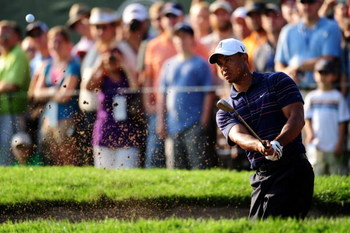 CHASKA, MN - AUGUST 11:  Tiger Woods plays from a bunker during the second preview day of the 91st PGA Championship at Hazeltine National Golf Club on August 11, 2009 in Chaska, Minnesota.  (Photo by Stuart Franklin/Getty Images)