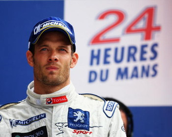 LE MANS, FRANCE - JUNE 14:   Alex Wurz of Austria and Peugeot stands on the podium after winning the Le Mans 24h race on June 14, 2009 in Le Mans, France.  (Photo by Bryn Lennon/Getty Images)