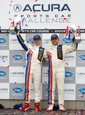 LEXINGTON, OH - AUGUST 08: Simon Pagenaud (L) and teammate Gil de Ferran (R), drivers of the #66 de Farran Motorsports XM Radio/Panasonic/Acura/Michelin Acura ARX-02a, celebrate after winning the LMP1 at the American Le Mans Series Acura Sports Car Challe