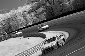 WATKINS GLEN, NY - AUGUST 10:  (EDITORS NOTE: AN INFRARED CAMERA WAS USED TO CREATE THIS IMAGE)  Tony Stewart, driver of the #14 Old Spice/Office Depot Chevrolet, leads a pack of cars during the NASCAR Sprint Cup Series Heluva Good! Sour Cream Dips at Wat