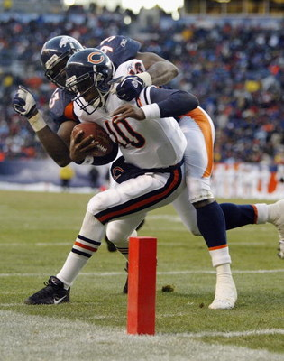 DENVER - NOVEMBER 23:  Quarterback Kordell Stewart #10 of the Chicago Bears gets run out of bounds by Trevor Pryce #93 of the Denver Broncos on November 23, 2003 at Invesco Field at Mile High in Denver, Colorado. The Bears defeated the Broncos 19-10.  (Ph