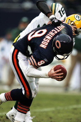 CHICAGO - JANUARY 2: Quarterback Chad Hutchinson #9 of the Chicago Bears is sacked by defensive end R-Kal Truluck #91 of the Green Bay Packers on January 2, 2005 at Soldier Field in Chicago, Illinois. The Packers defeated the Bears 31-14. (Photo by Jonath