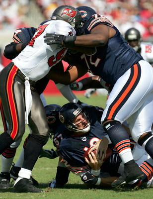 TAMPA, FL - OCTOBER 24:  Quarterback Jonathan Quinn #12 of the Chicago Bears is sacked by Greg Spires #94 of the Tampa Bay Buccaneers during the first half of the game at Raymond James Stadium on October 24, 2004 in Tampa, Florida. (Photo by Jamie Squire/