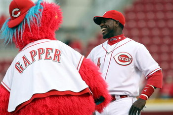 CINCINNATI, OH - APRIL 8:  Brandon Phillips #4 of the Cincinnati Reds laughs with mascot Gapper prior to the game against the New York Mets on April 8, 2009 at Great American Ballpark in Cincinnati, Ohio.  The Mets won 9-7.  (Photo by Mark Lyons/Getty Ima