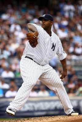 NEW YORK - AUGUST 08:  CC Sabathia #52 of the New York Yankees pitches against the Boston Red Sox during their game on August 8, 2009 at Yankee Stadium in the Bronx borough of New York City.  (Photo by Chris McGrath/Getty Images)