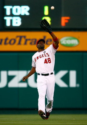 ANAHEIM, CA - JULY 07:  Torii Hunter #48 of the Los Angeles Angels of Anaheim catches a pop fly in the second inning against the Texas Rangers at Angel Stadium on July 7, 2009 in Anaheim, California. The Rangers defeated the Angels 8-5.  (Photo by Jeff Gr