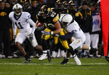 IOWA CITY, IA - NOVEMBER 8:  Tony Davis #11 and his teammate Josh Hull #43 of the Penn State Nittany Lions tackle tight end Brandon Myers #83 of the Iowa Hawkeyes as he rushes for yards in the fourth quarter of play at Kinnick Stadium on November 8, 2008