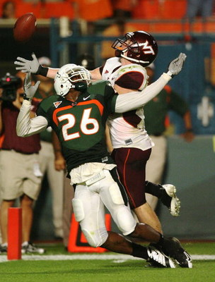 MIAMI - NOVEMBER 13:  Defensive back Anthony Reddick #26 of the Miami Hurricanes knocks the pass away from wide receiver Danny Coale #19 of the Virginia Tech Hokies at Dolphin Stadium on November 13, 2008 in Miami, Florida. Miami defeated Virginia Tech 16