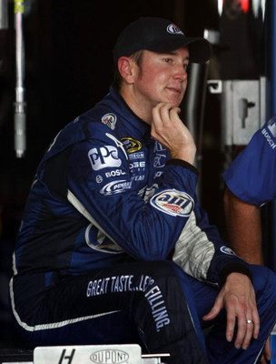 WATKINS GLEN, NY - AUGUST 08:  Kurt Busch, driver of the #2 Miller Lite Dodge, sits in the garage during practice for the NASCAR Sprint Cup Series Heluva Good! Sour Cream Dips at Watkins Glen International on August 8, 2009 in Watkins Glen, New York.  (Ph