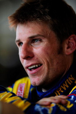 DAYTONA BEACH, FL - JULY 02: Jamie McMurray, driver of the #26 IRWIN Marathon Ford, stands in the garage area during practice for the NASCAR Sprint Cup Series Coke Zero 400 at Daytona International Speedway on July 2, 2009 in Daytona Beach, Florida.  (Pho