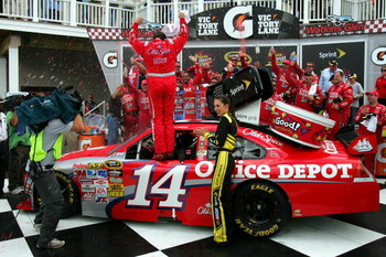 WATKINS GLEN, NY - AUGUST 10:  Tony Stewart (R), driver of the #14 Old Spice Chevrolet, celebrates in victory lane after winning the NASCAR Sprint Cup Series Heluva Good! Sour Cream Dips at Watkins Glen International on August 10, 2009 in Watkins Glen, Ne
