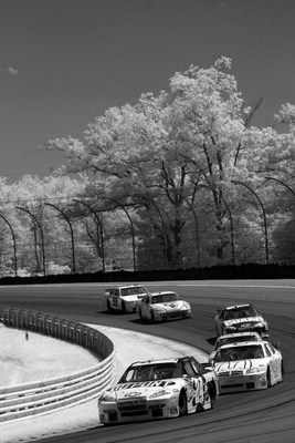 WATKINS GLEN, NY - AUGUST 10:   (EDITORS NOTE: AN INFRARED CAMERA WAS USED TO CREATE THIS IMAGE)  Jeff Gordon, driver of the #24 DuPont Chevrolet leads a pack of cars during the NASCAR Sprint Cup Series Heluva Good! Sour Cream Dips at Watkins Glen Interna