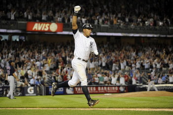 NEW YORK - AUGUST 07:  Alex Rodriguez #13 of the New York Yankees celebrates a walk off home run against the Boston Red Sox in the 15th inning on August 7, 2009 at Yankee Stadium in the Bronx borough of New York City.  The New York Yankees defeated the Bo