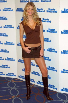 401315 18: Model Marissa Miller poses for photographers at the unveiling of 2002 Sports Illustrated Swimsuit edition February 19, 2002 in New York City. The cover features model Yamila-Daiz Rahl. (Photo by Lawrence Lucier/Getty Images)