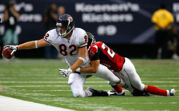 ATLANTA - OCTOBER 12:  Tight end Greg Olsen #82 of the Chicago Bears reaches for the sideline against Brent Grimes #20 of the Atlanta Falcons during the game at the Georgia Dome on October 12, 2008 in Atlanta, Georgia.  (Photo by Kevin C. Cox/Getty Images