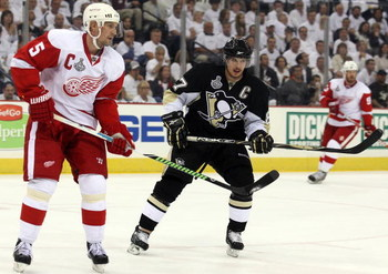 PITTSBURGH - JUNE 04:  Sidney Crosby #87 of the Pittsburgh Penguins skates against Nicklas Lidstrom #5 of the Detroit Red Wings during Game Four of the 2009 NHL Stanley Cup Finals on June 4, 2009 at Mellon Arena in Pittsburgh, Pennsylvania.  (Photo by Jim