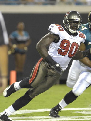JACKSONVILLE, FL - AUGUST 18: Defensive end Gaines Adams #90  of the Tampa Bay Buccaneers rushes the pocket against the Jacksonville Jaguars at Jacksonville  Municipal Stadium on August 18, 2007 in Jacksonville, Florida. (Photo by Al Messerschmidt/Getty I