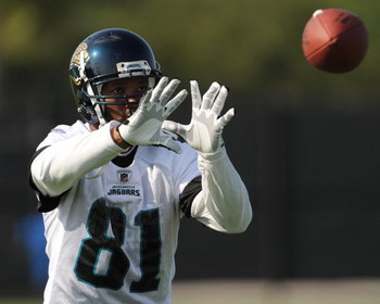 JACKSONVILLE, FL - MAY 1:  Wide receiver Torry Holt #81 of the Jacksonville Jaguars reaches for a pass during a team mini-camp on May 1, 2009 on the practice fields at Jacksonville Municipal Stadium in Jacksonville, Florida.  (Photo by Al Messerschmidt/Ge
