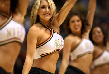 BOISE, ID - MARCH 20:  Cheerleaders for the Florida State Seminoles dance during the game against the Wisconsin Badgers in first round of the NCAA Division I Men's Basketball Tournament at the Taco Bell Arena on March 20, 2009 in Boise, Idaho.  (Photo by