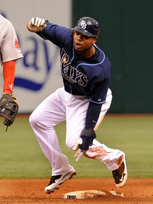 ST. PETERSBURG, FL - MAY 3: Outfielder Carl Crawford #13 of the Tampa Bay Rays steals second base against the Boston Red Sox May 3, 2009 at Tropicana Field in St. Petersburg, Florida. (Photo by Al Messerschmidt/Getty Images)