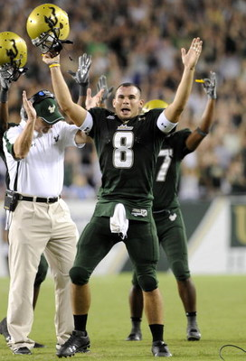 TAMPA, FL - SEPTEMBER 12: Quarterback Matt Grothe #8 of the University of South Florida Bulls celebrates a touchdown against the Kansas University Jayhawks at Raymond James Stadium on September 12, 2008 in Tampa, Florida.  (Photo by Al Messerschmidt/Getty