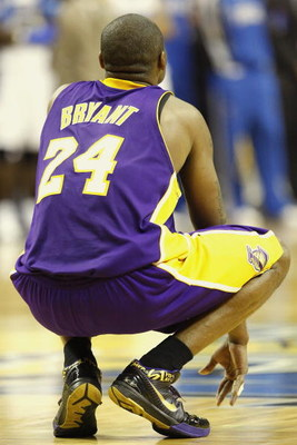 ORLANDO, FL - JUNE 14:  Kobe Bryant #24 of the Los Angeles Lakers rests for a moment in Game Five of the 2009 NBA Finals against the Orlando Magic on June 14, 2009 at Amway Arena in Orlando, Florida. The Lakers won 99-86.  NOTE TO USER:  User expressly ac