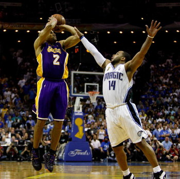 ORLANDO, FL - JUNE 11:  Derek Fisher #2 of the Los Angeles Lakers shoots a game-tying three-point shot over Jameer Nelson #14 of the Orlando Magic in the fourth quarter of Game Four of the 2009 NBA Finals on June 11, 2009 at Amway Arena in Orlando, Florid