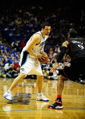 ORLANDO, FL - APRIL 28: Hedo Turkoglu #15 of the Orlando Magic looks to pass against Andre Iguodala #9 of the Philadelphia 76ers in Game Five of the Eastern Conference Quarterfinals during the 2009 NBA Playoffs at Amway Arena on April 28, 2009 in Orlando,