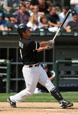 CHICAGO - JUNE 08: Paul Konerko #14 of the Chicago White Sox follows the flight of his 8th home run of the season, a solo shot in the 8th inning, against the Detroit Tigers on June 8, 2009 at U.S. Cellular Field in Chicago, Illinois. The Tigers defeated t