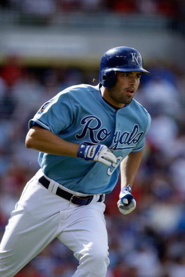 KANSAS CITY, MO - JUNE 20:  David DeJesus #9 of the Kansas City Royals runs to first against the St. Louis Cardinals during the game on June 20, 2009 at Kauffman Stadium in Kansas City, Missouri. (Photo by Jamie Squire/Getty Images)