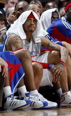 CLEVELAND - FEBRUARY 22: Allen Iverson #1 of the Detroit Pistons looks on from the bench during a loss to the Cleveland Cavaliers on February 22, 2009 at the Quicken Loans Arena in Cleveland, Ohio. Cleveland won the game 99-78. NOTE TO USER: User expressl