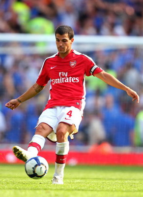 LONDON, ENGLAND - AUGUST 02:  Cesc Fabregas of Arsenal passes the ball during the Emirates Cup match between Arsenal and Glasgow Rangers at the Emirates Stadium on August 2, 2009 in London, England.  (Photo by Phil Cole/Getty Images)