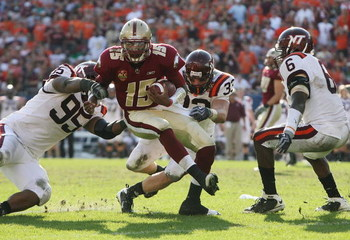 TAMPA, FL - DECEMBER 06:  Quarterback Dominique Davis #15 of the Boston College Eagles is brought down by defensive tackle Cordarrow Thompson #95, linebacker Brett Warren #33 and defensive end Jason Worilds #6 of the Virginia Tech Hokies in the 2008 ACC F