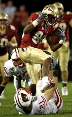 ORLANDO, FL - DECEMBER 27:  Jarmon Fortson #80 of the Florida State Seminoles steps on Chris Maragos #21 of the Wisconsin Badgers after a reception during the Champs Bowl on December 27, 2008 at the Citrus Bowl in Orlando, Florida.  (Photo by Sam Greenwoo