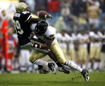 JACKSONVILLE, FL - DECEMBER 02:  Wide Receiver James Johnson #89 of the Georgia Tech Yellow Jackets cannot make the catch as free safety Chip Vaughn #9 of the Wake Forest Demon Deacons seperates him from the ball during the Atlantic Coast Conference Champ