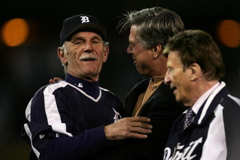 DETROIT - OCTOBER 14:  Manager Jim Leyland (L) and General Manager Dave Dombrowski (C) of the Detroit Tigers celebrate after the Tigers won 6-3 against the Oakland Athletics during Game Four of the American League Championship Series October 14, 2006 at C